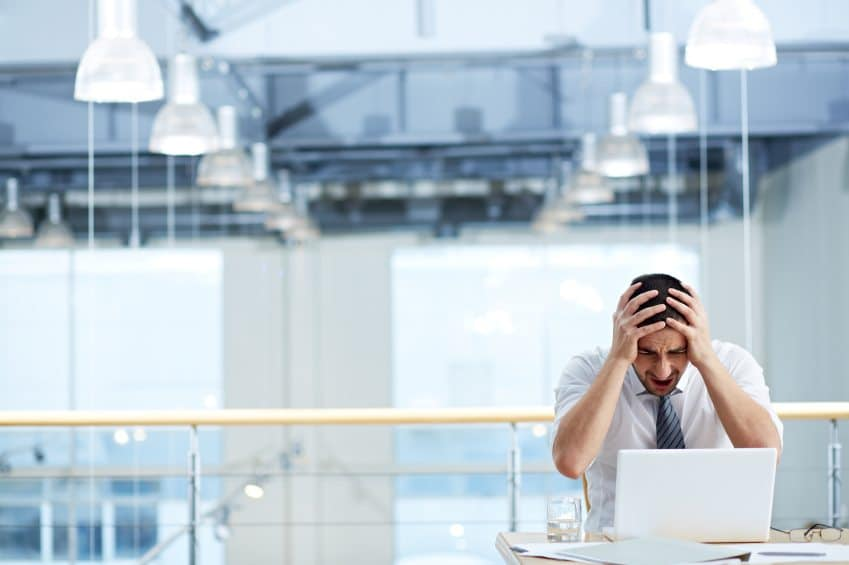 Outsourcing overseas - Stressed businessman