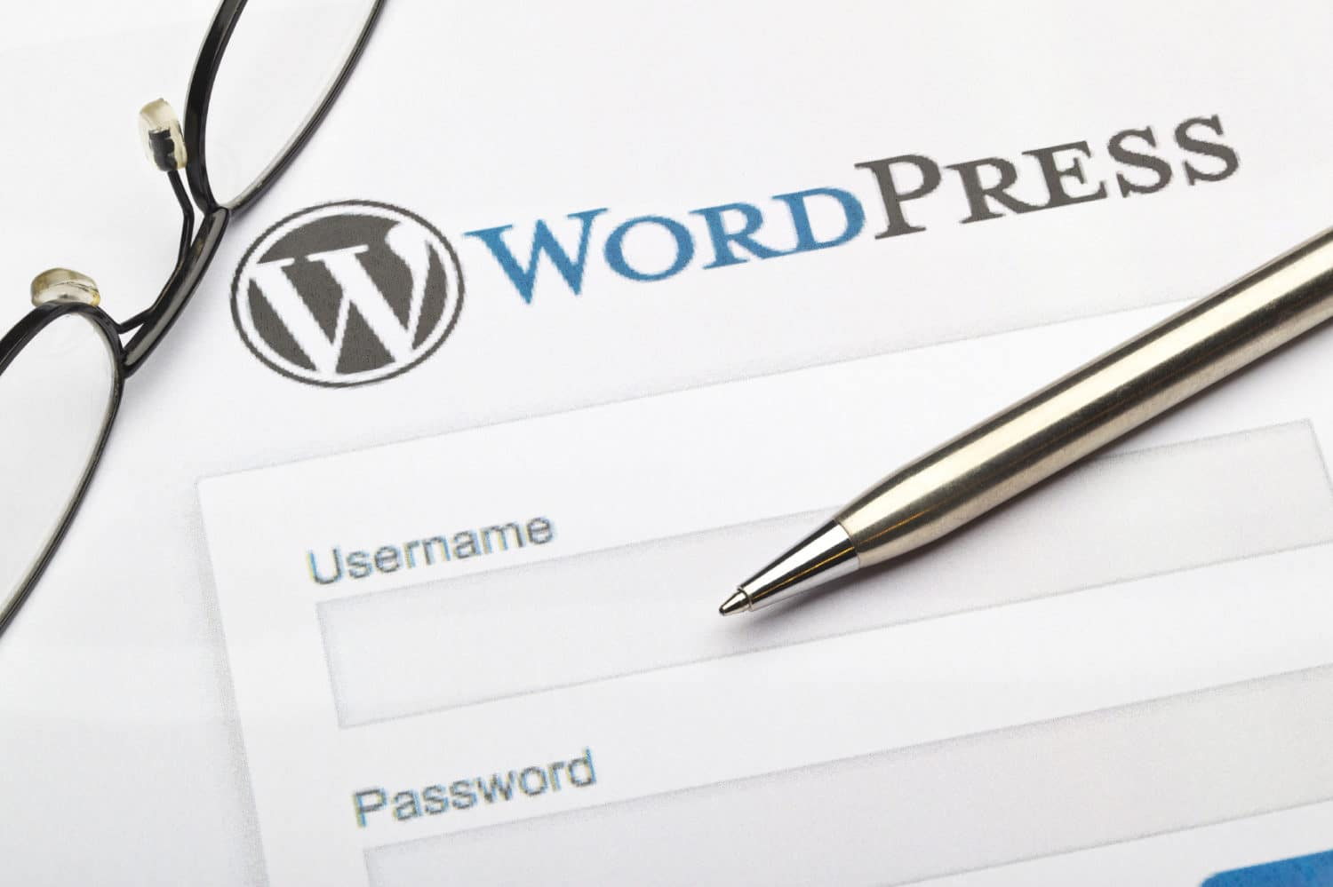 Digital marketing and Wordpress image example with pen and screen showing.