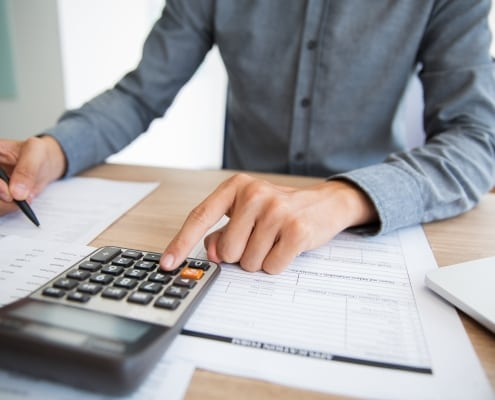Accountant examining financial report